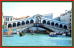 View the famous stone arches of the Ponte di Rialto.
