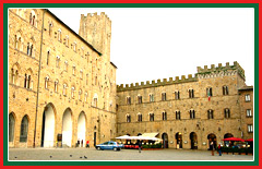 View the Romanesque - Gothic style architecture of the Volterra town hall.
