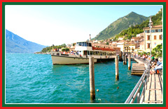 View the shoreline luxury villas of Lake Garda.
