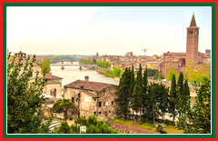 Heritage buildings line the loop of the Adige River in Verona.